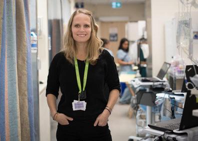 A woman with medium-length hair smiles.