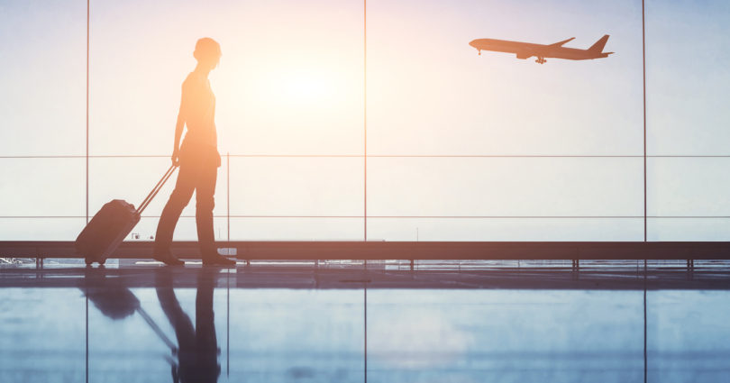 woman in silhouette at airport