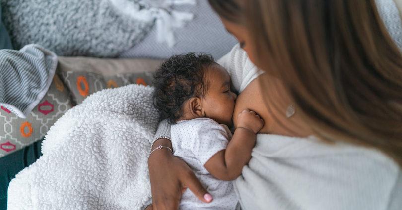 A woman breastfeeding her baby.