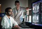 Medical physicist Ananth Ravi (left) and radiation oncologist Dr. Eric Leung review imaging from the MRI-Brachytherapy Suite
