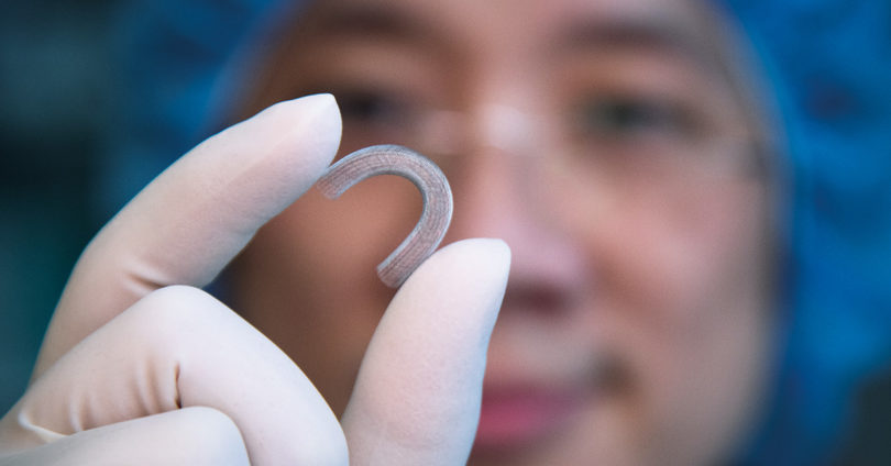 Neurosurgeon and senior scientist Dr. Victor Yang holding a stent.