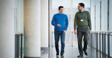Alan MacDonald (left) walks with clinical psychologist Dr. Sam Iskandar at St. John's Rehab.