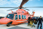 A stretcher is carried off an Ornge helicopter on Sunnybrook's new helipad.