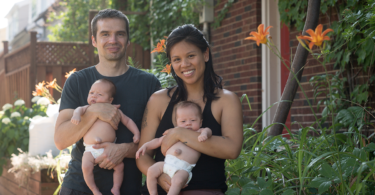 Jessica and Tim pose with their twin boys