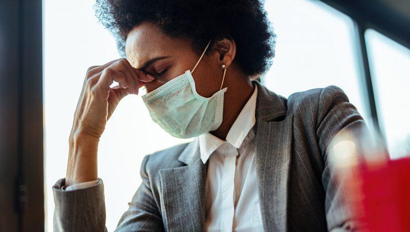 A lady wearing a mask.