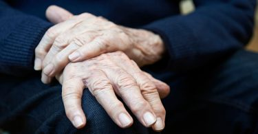 Closeup Of Senior Man Suffering With Parkinson's Disease