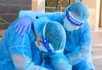health-care worker comforts colleague during pandemic