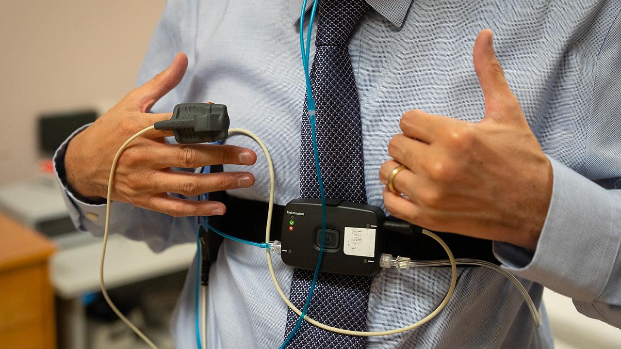 Dr. Mark Bolous wears a sleep monitor